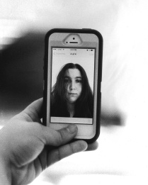 Traditional film photograph of a self portrait. Selfie-ception.