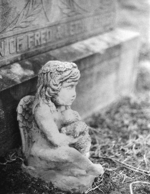 Traditional film photograph of an old grave belonging to a child who died in 1912.